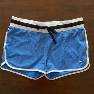 Blue Nike mesh athletic shorts